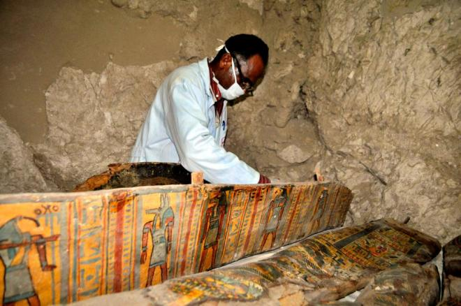 The coffins were covered with intricate drawings in red, blue, black, green, and yellow