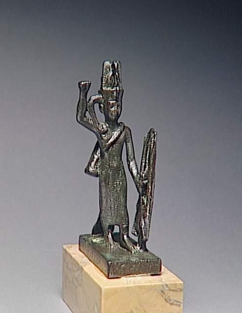 Statuette du dieu guerrier reshep tenant arc fleches et bouclier