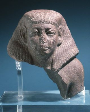 Fragment from a red porphiry statue of a court official