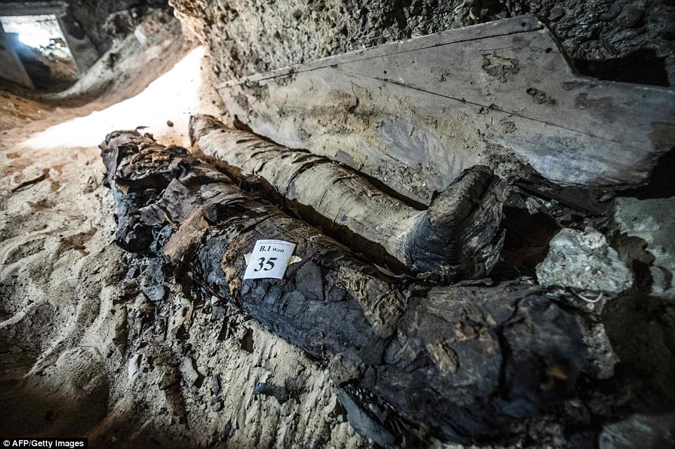 Two mummies, mostly intact, inside the burial site