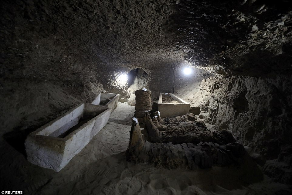 Several mummies lying in one of the burial site's many passageways.
