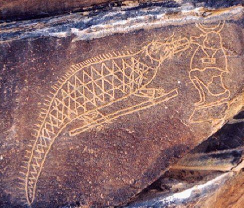 Crocodile du Wadi hammamat face à un babouin.